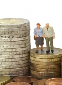 An older couple stood on a pile of coins -resized.jpg